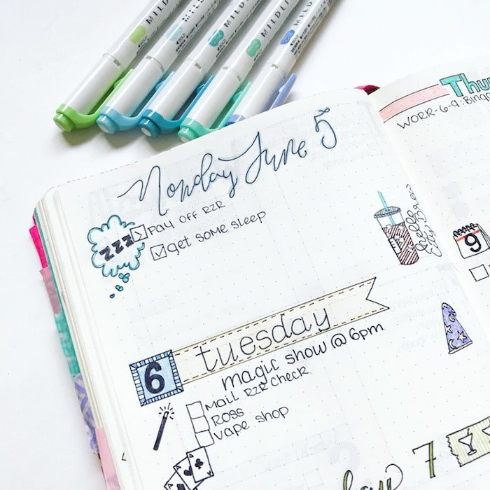 Bullet journal supplies and daily spread