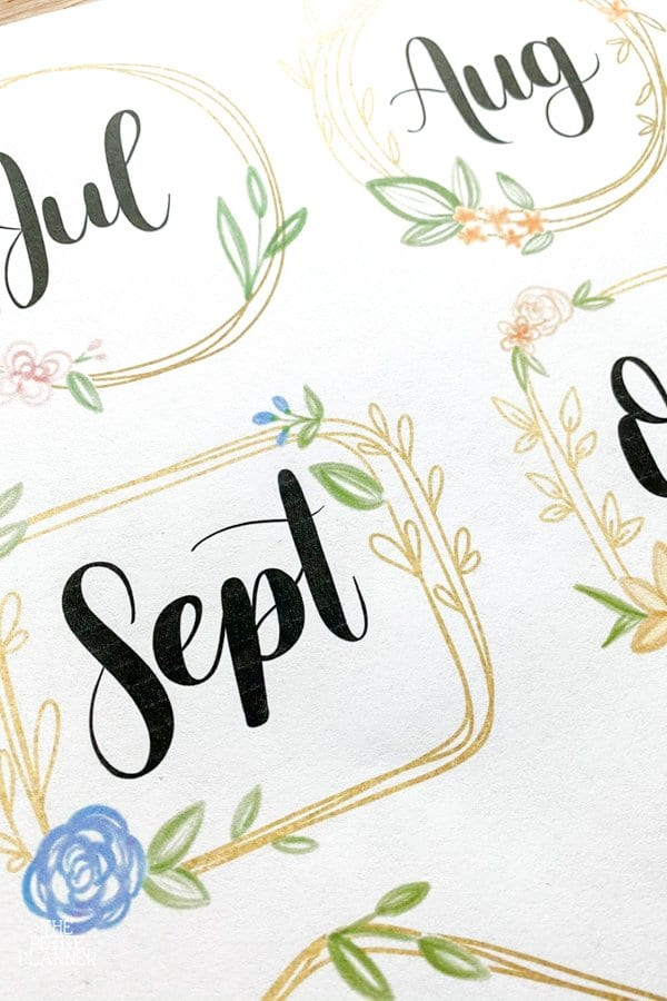 Gold floral months of the year names printed on paper