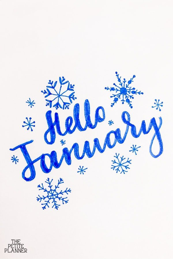 Blue hand lettered words that say Hello January for bullet journal cover