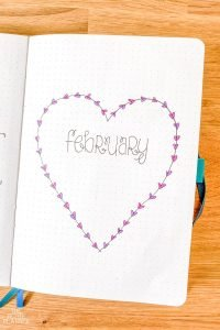 February Bullet Journal Cover Page with a large heart and small hearts