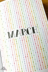 March Bullet Journal Monthly Cover Page with Rainbow Colored Lines and Dots
