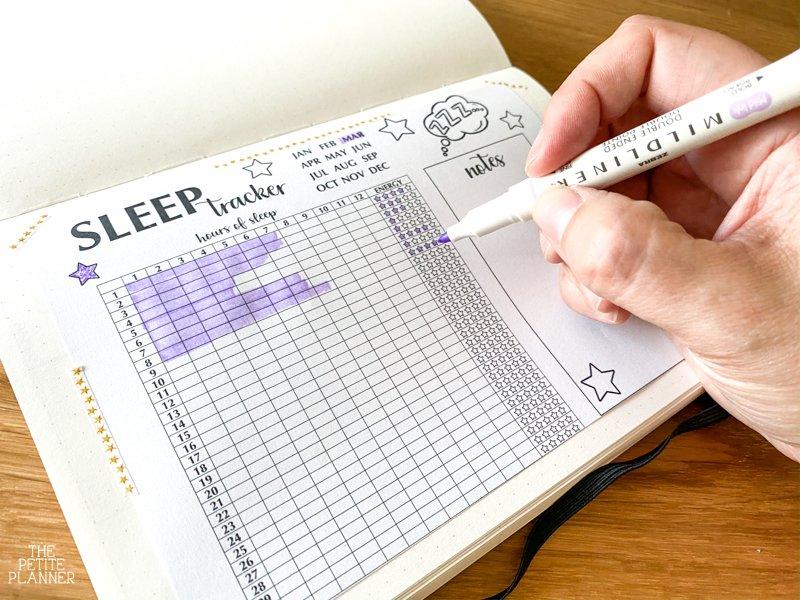 Bullet journal sleep log printable page in a journal