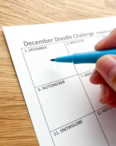 Drawing on a printable December doodle sheet