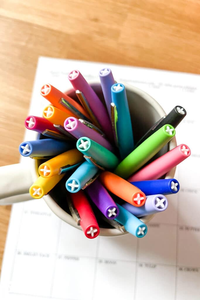 Cup holding rainbow colors of Flair pens