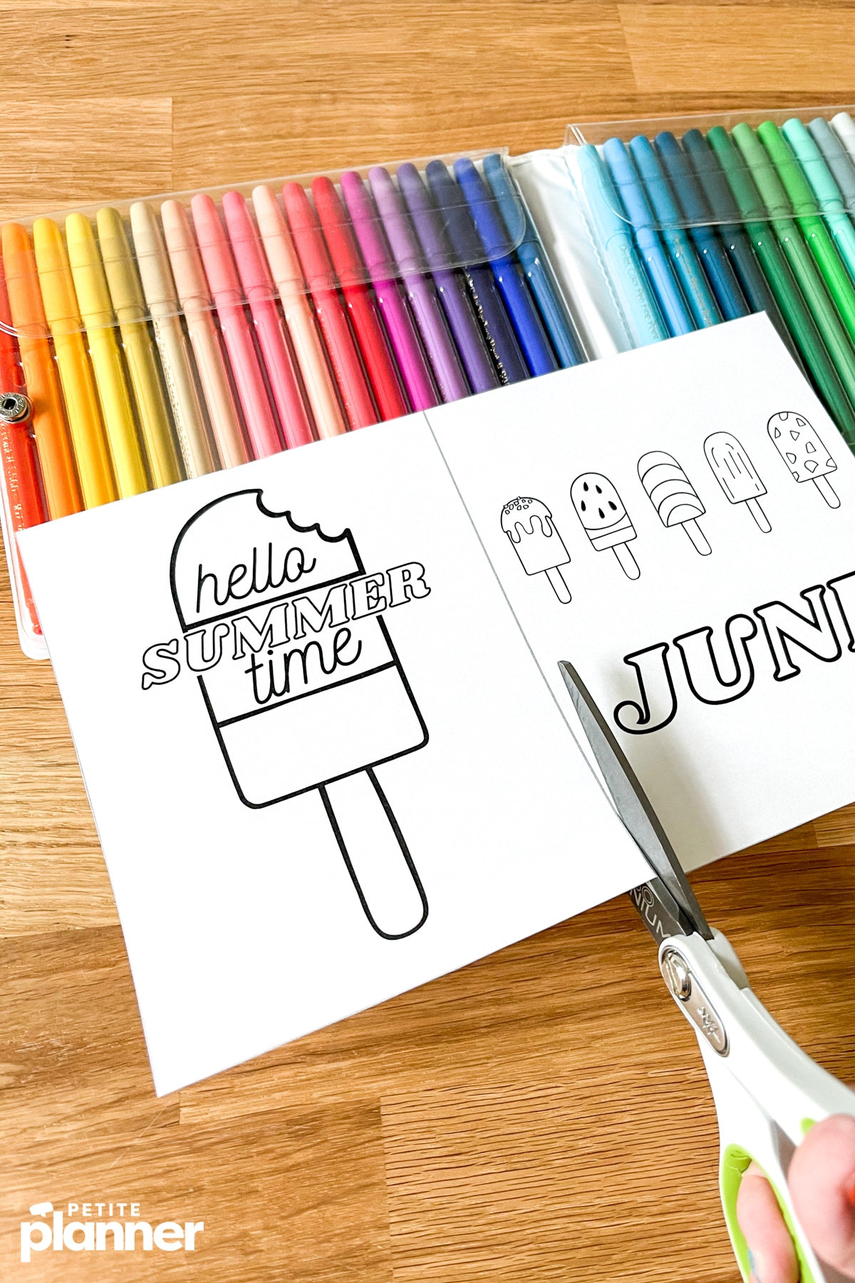 Using scissors to cut printable June bullet journal pages