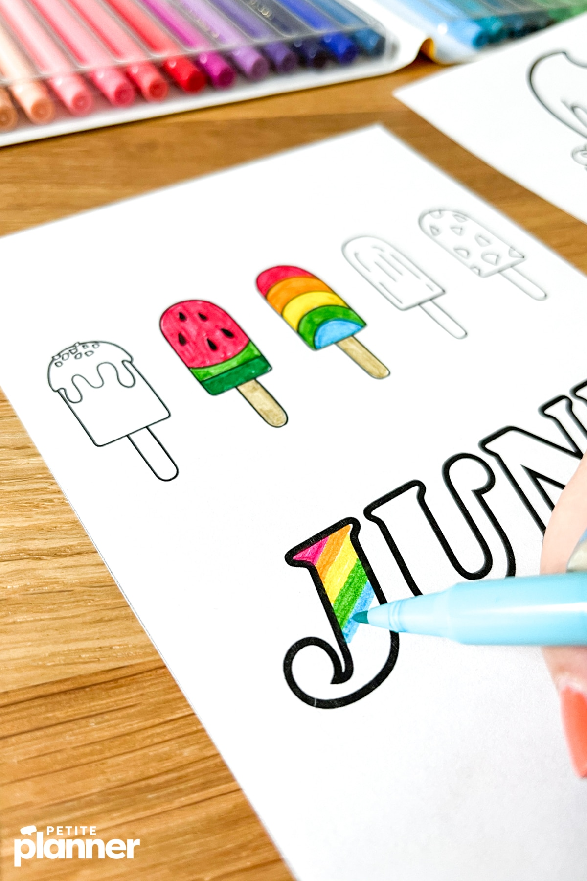Coloring June cover page with markers